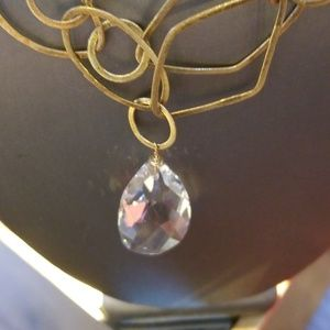 GORGEOUS BIG CRYSTAL HANGING FROM GOLD !